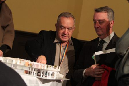 Minister Foley and Peter McEwan looking at the a 3D model of the Pride Centre