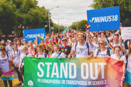 Young people gather together against homophobia