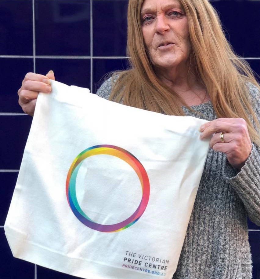 Sally holding our new tote bag