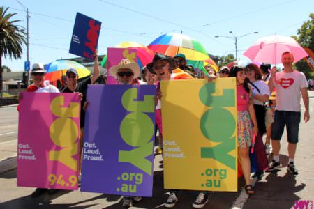 JOY Presenters and volunteers marching together at Pride March 2019