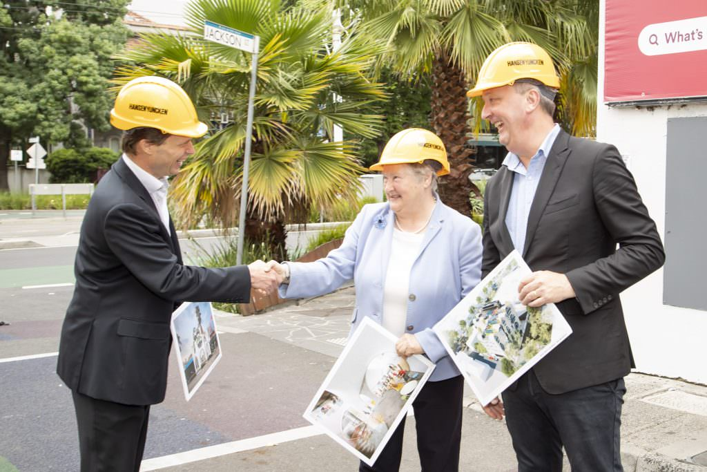 Richard Hansen shanking hands with Jude Munro outside the site of the Victorian Pride Centre, with Martin Foley MP, Minister for Equality