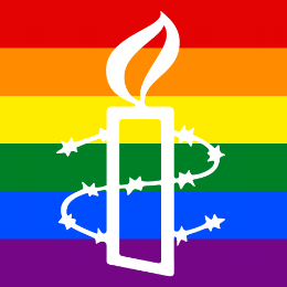 The Amensty Logo over a rainbow flag