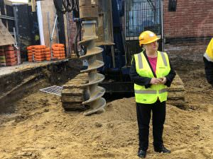 Jude Munro inspecting works on site at the Victorian Pride Centre