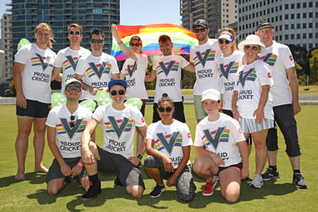 Proud Cricket Team with Rainbow Flag