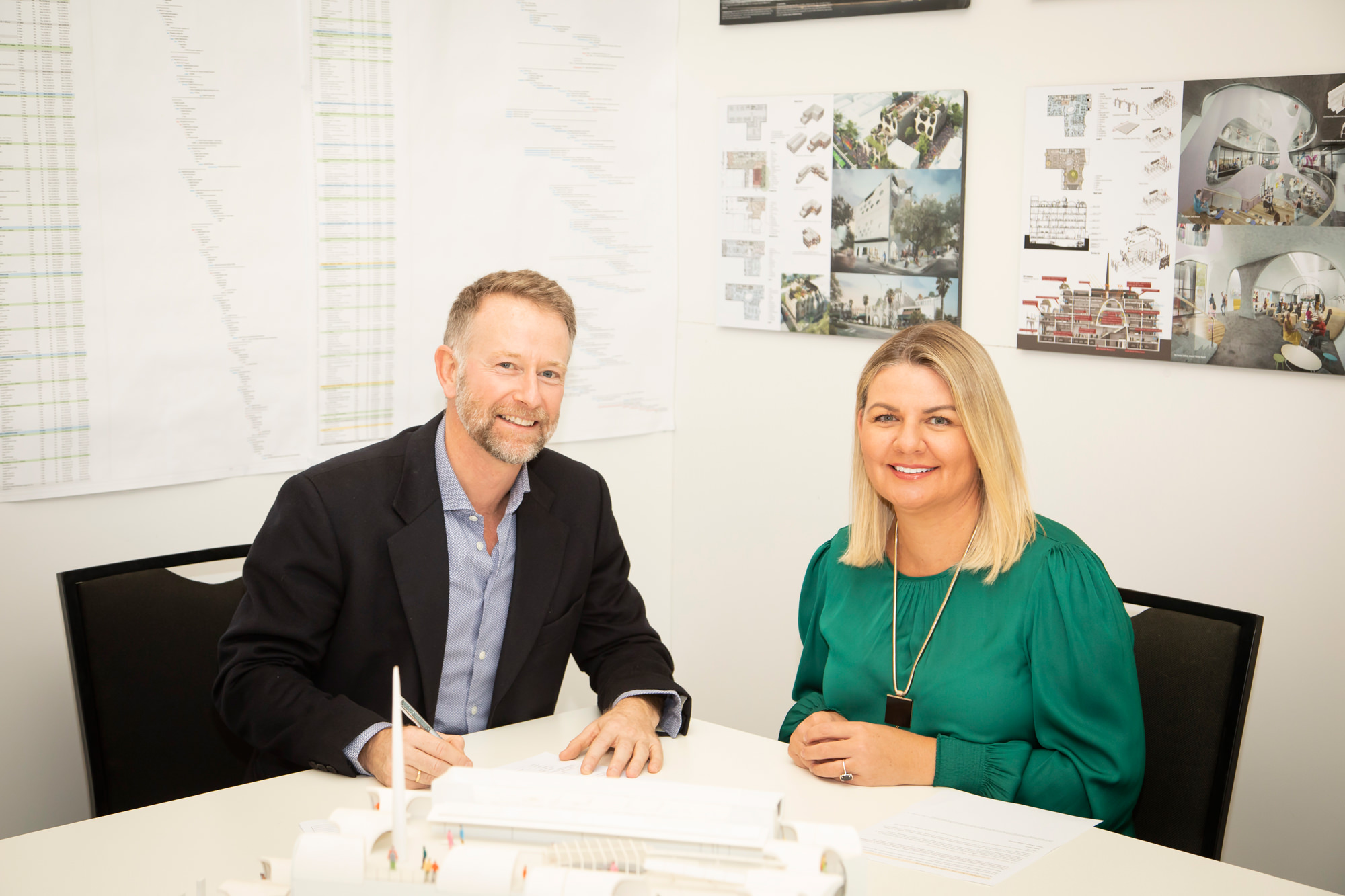VPC Acting Chair Stuart Kollmorgen and Lifeview CEO Madeline Gall, sign partnership agreement on the site of the Victorian Pride Centre, due to open late 2020
